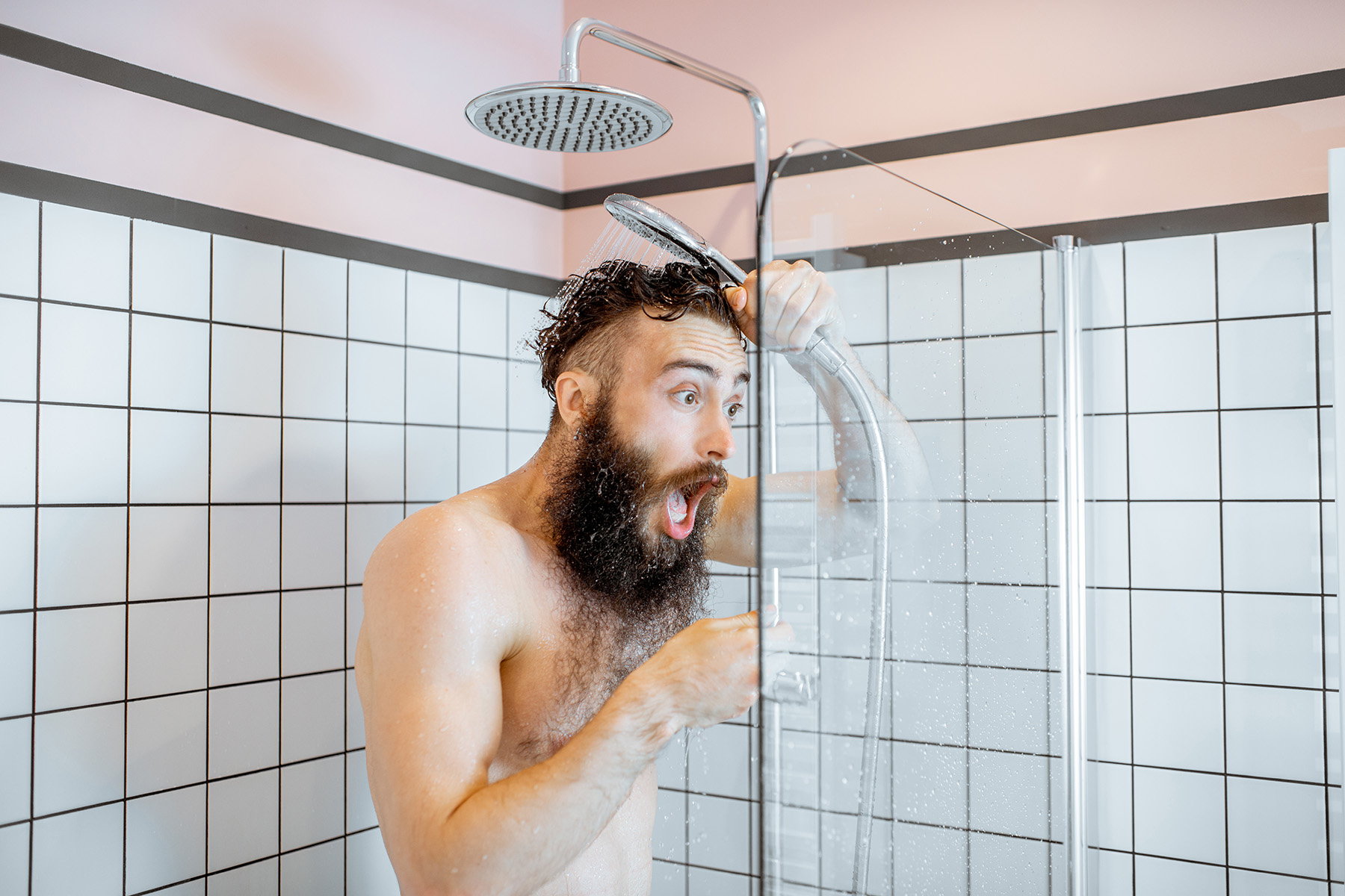 Surprised man in shower