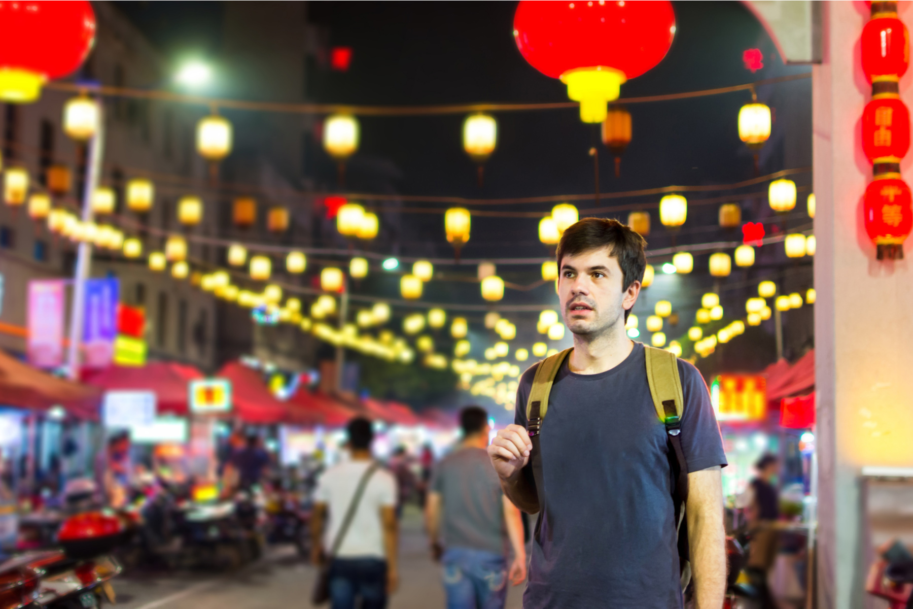 Young man in an Asian city