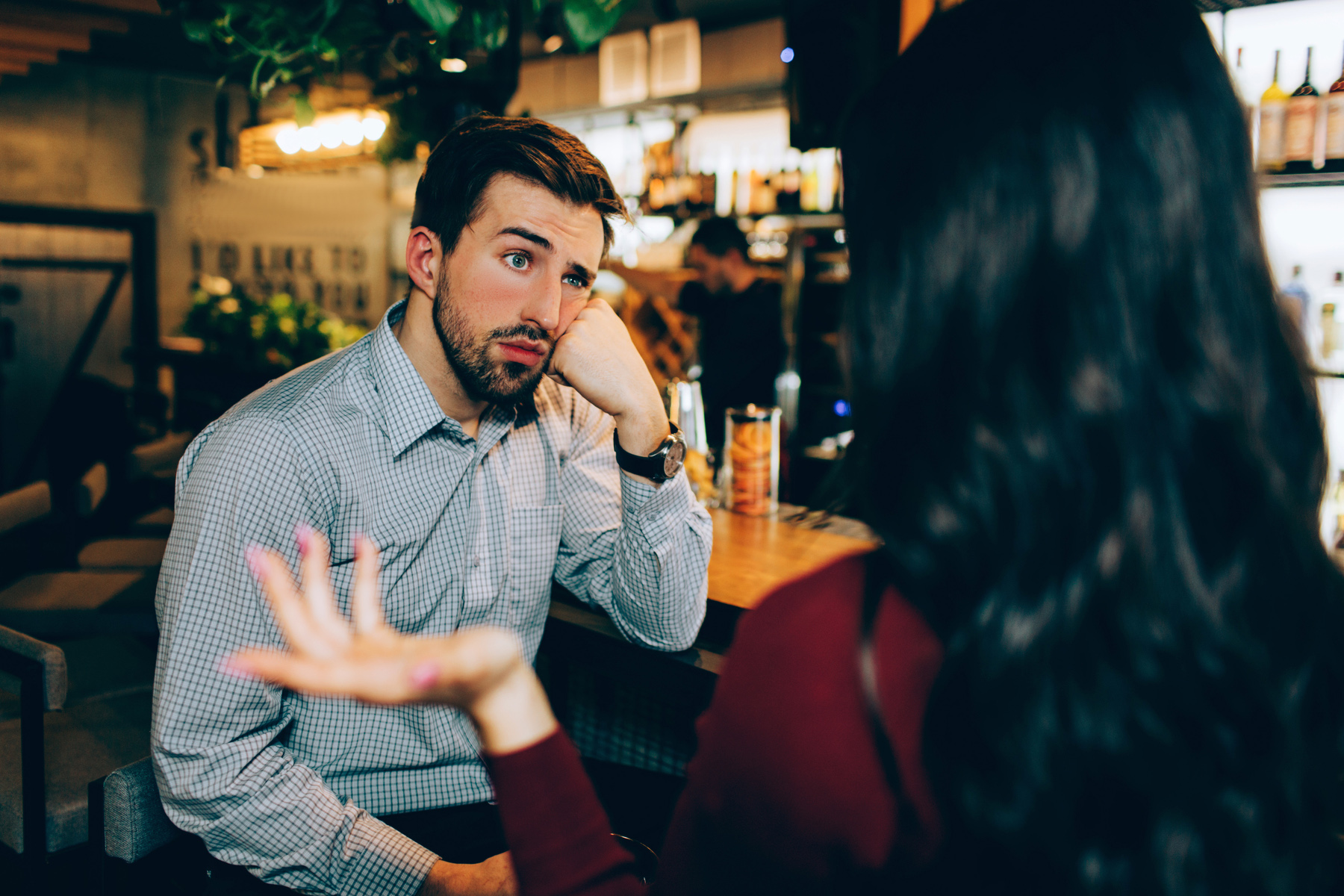 Man visibly bored on a date