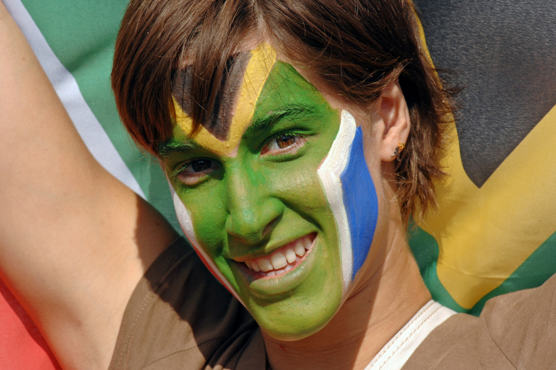 South African woman with her face painted