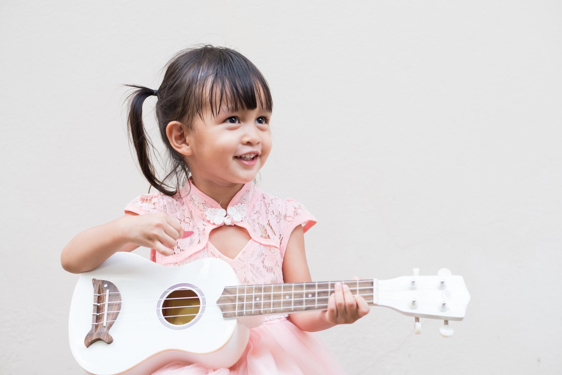 Child playing ukulele
