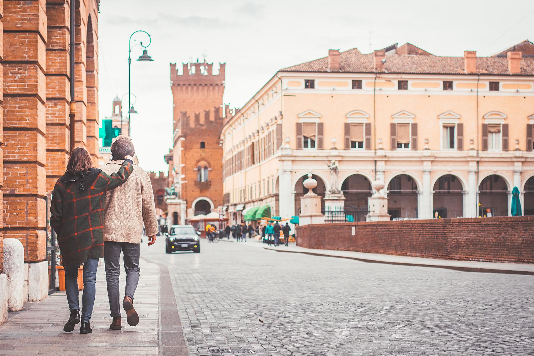 Couple walking in Ferrara