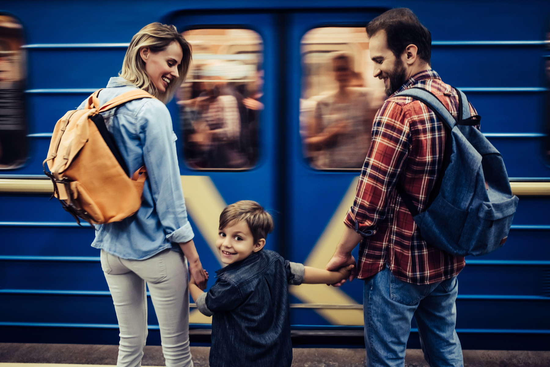Family waiting for a metro train