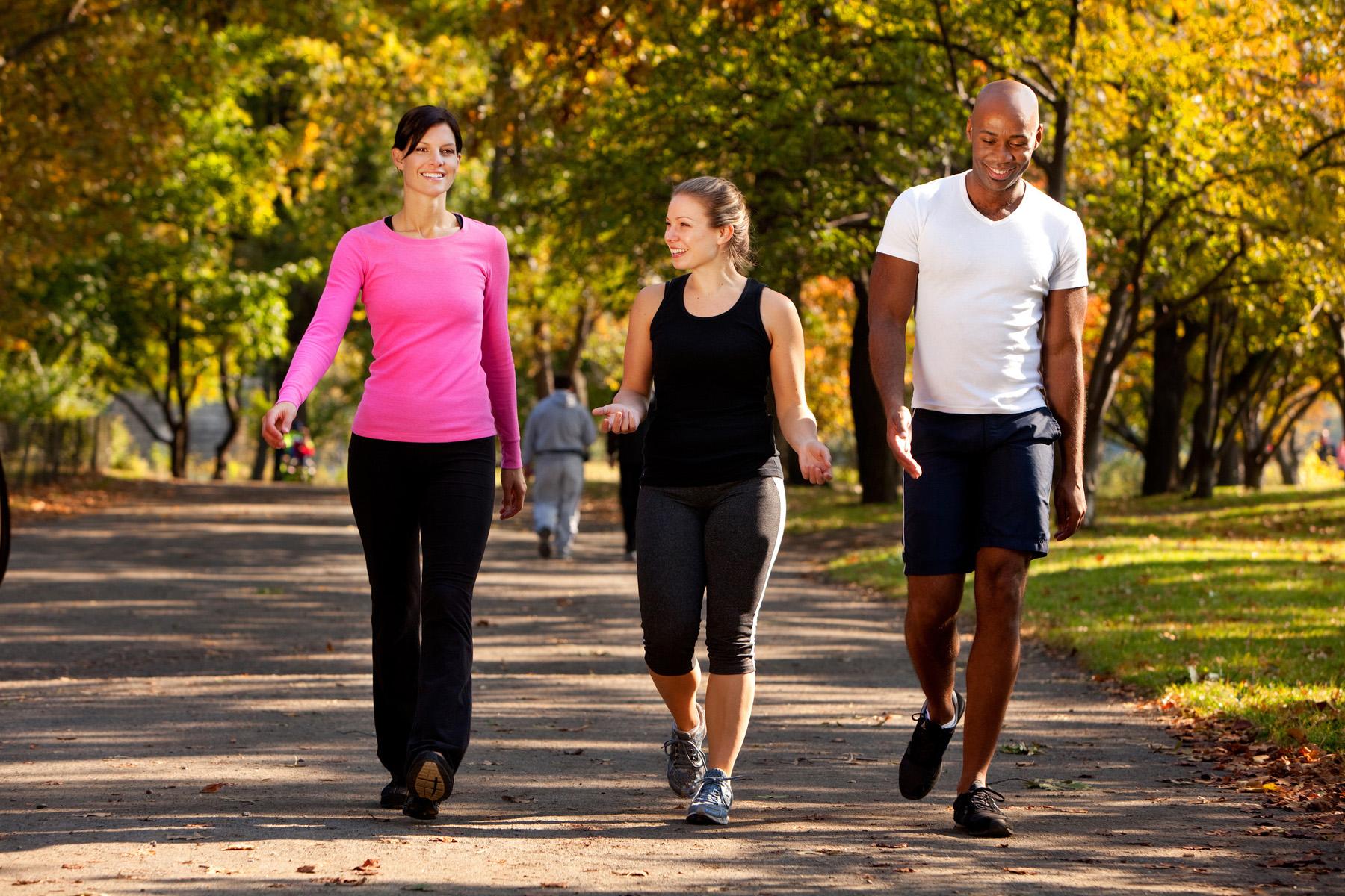 Friends walking in a park