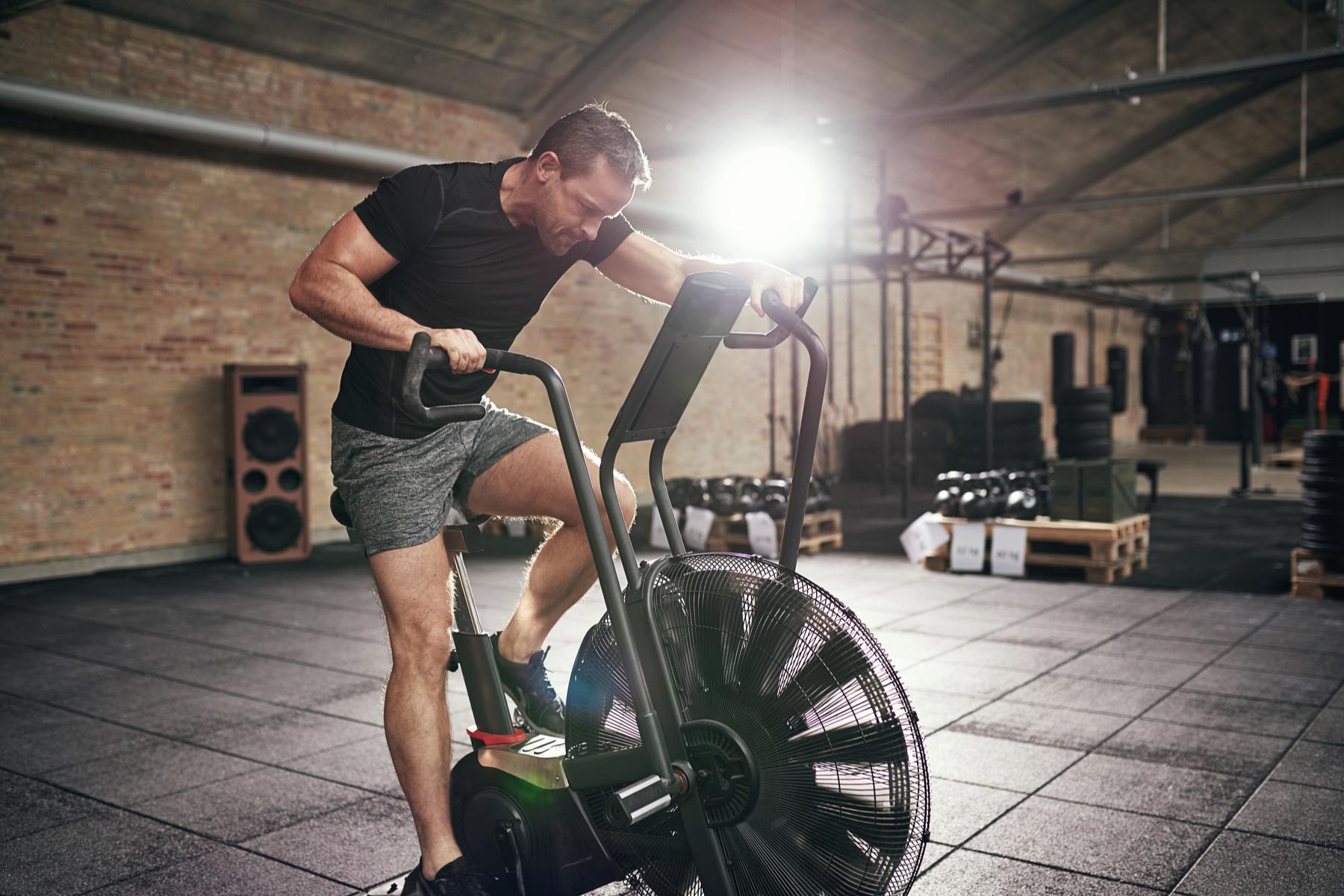 Man cycling at a gym