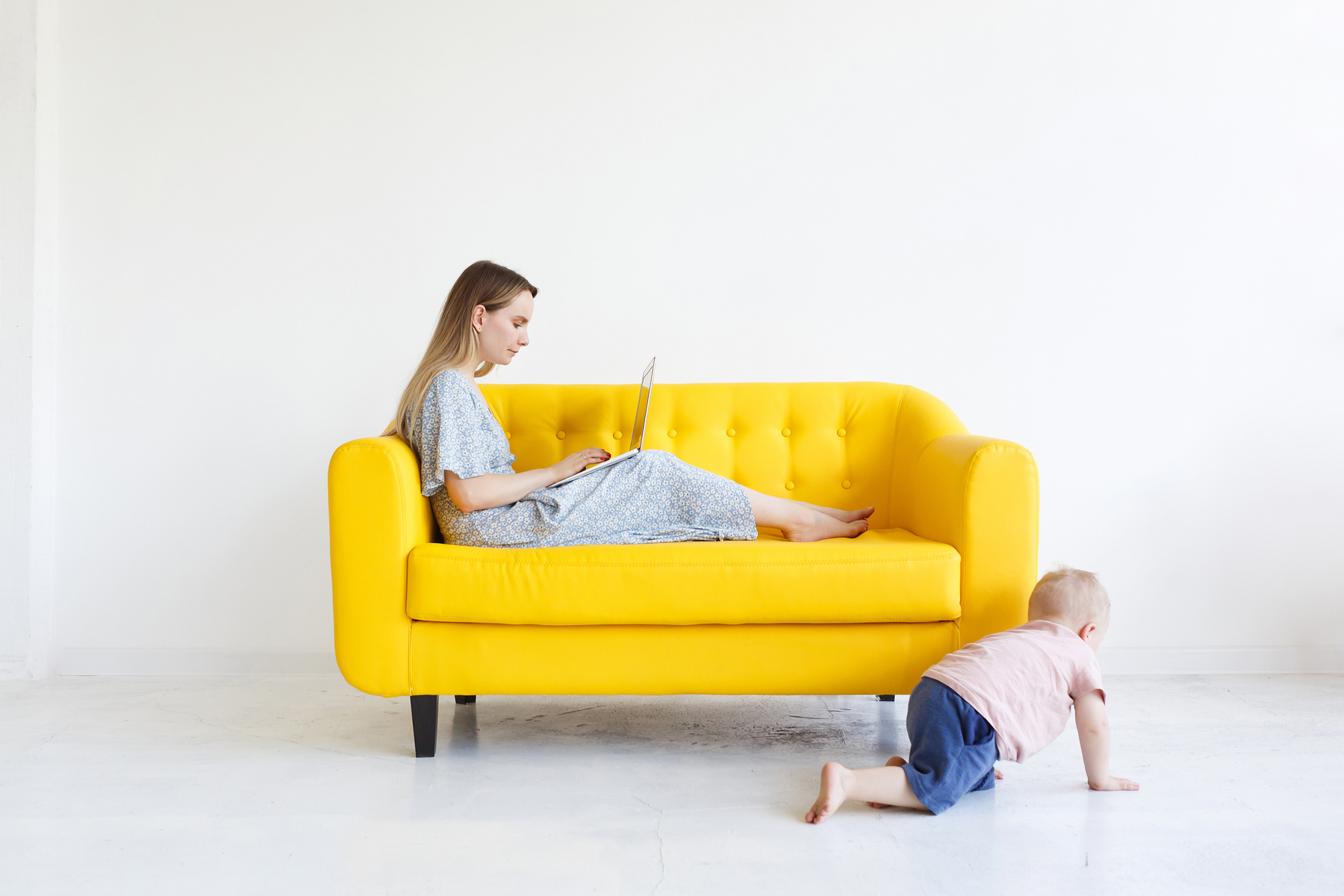 A mother working from home