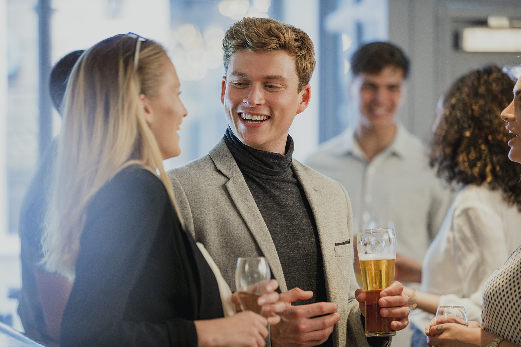 A group networking over drinks