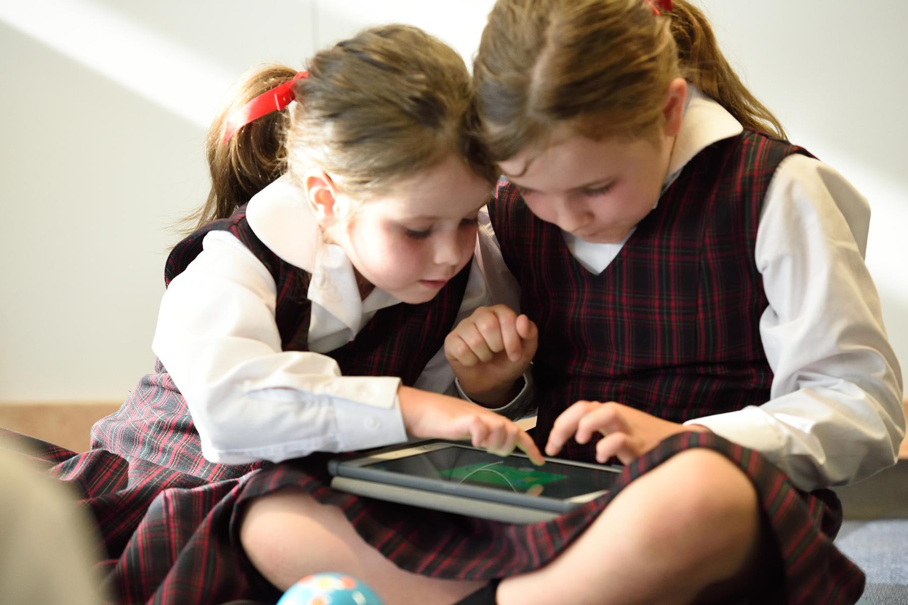 Schoolchildren using a tablet at school