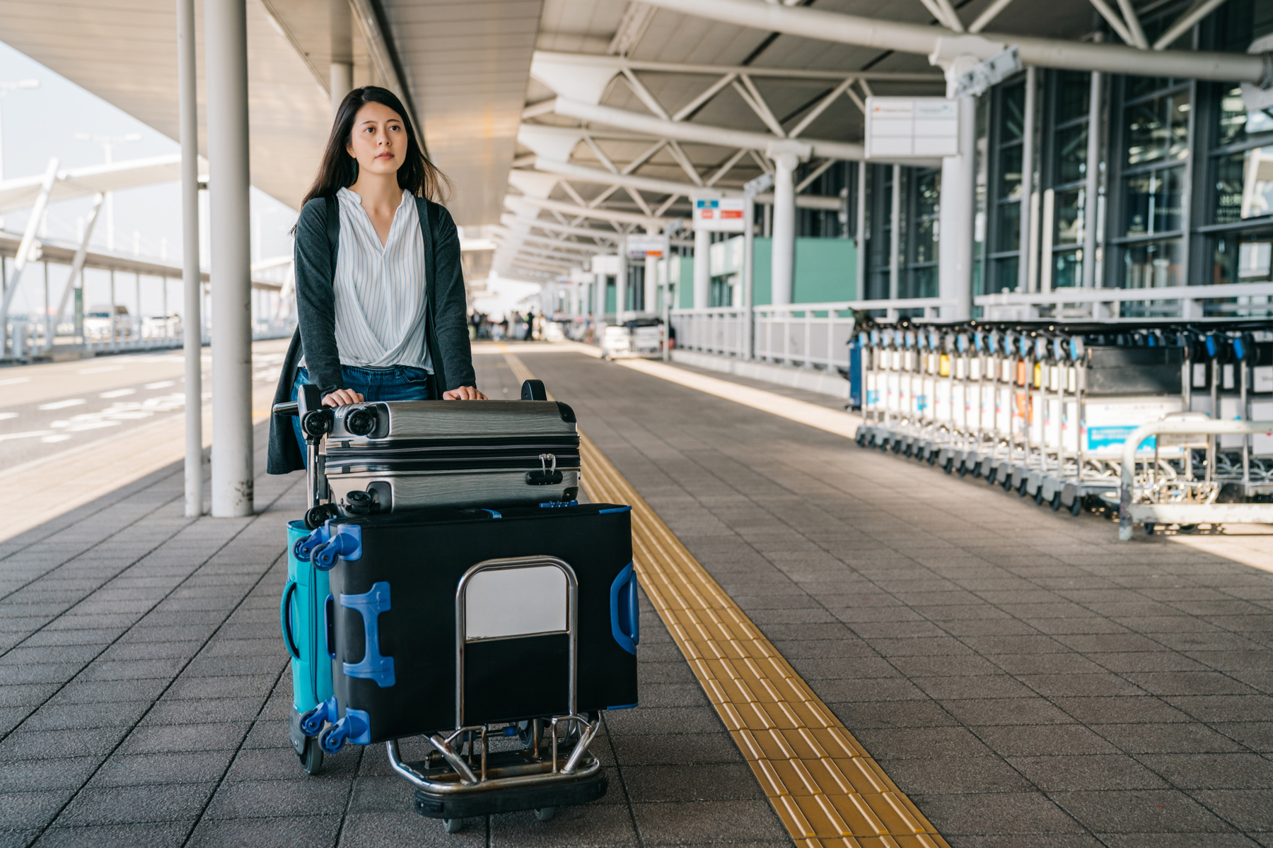 Woman with luggage at an airport