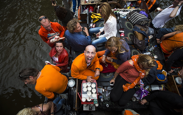 people celebrating king's day on boat