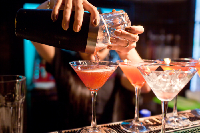 Woman serving cocktails