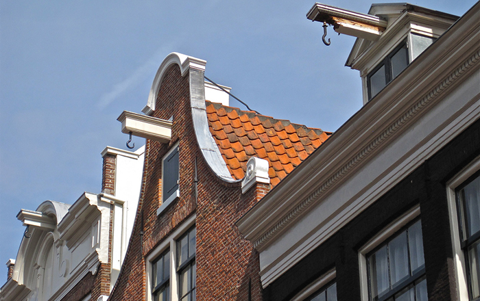 Many people in the Netherlands move house using the iron hooks at the top of the building