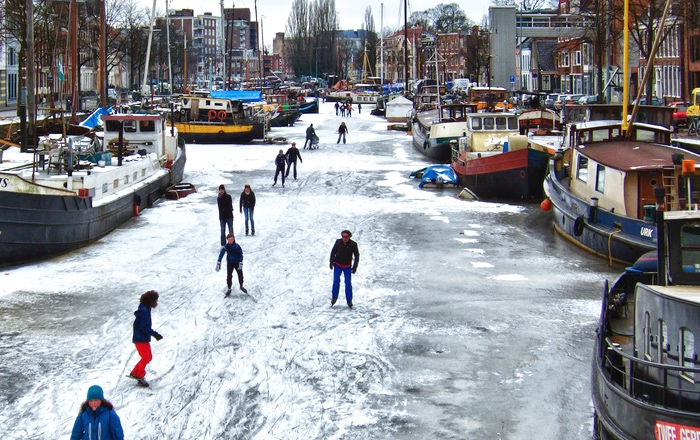 Ice skating on frozen canals in Amsterdam