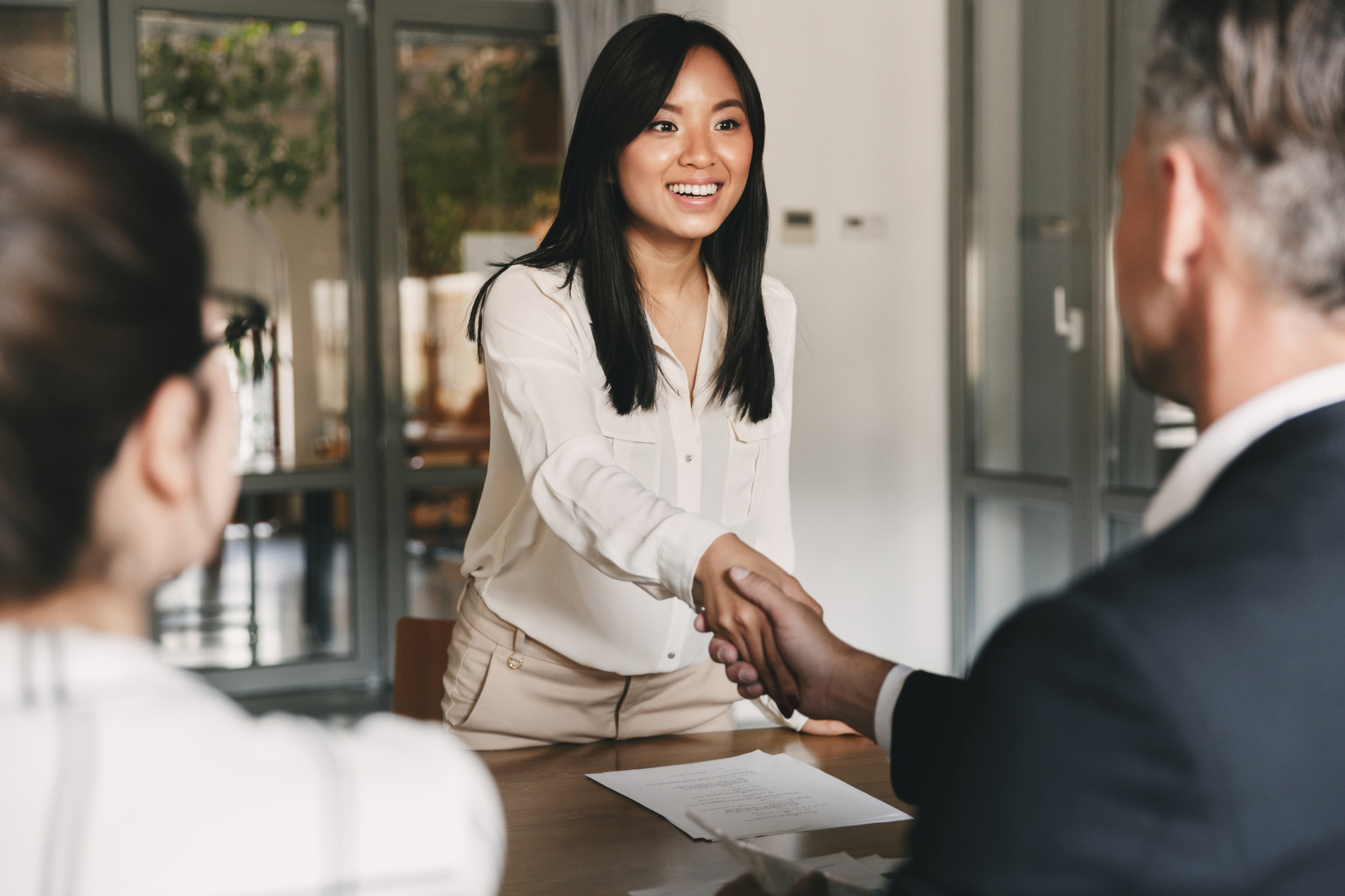 Applicant giving a handshake at a job interview