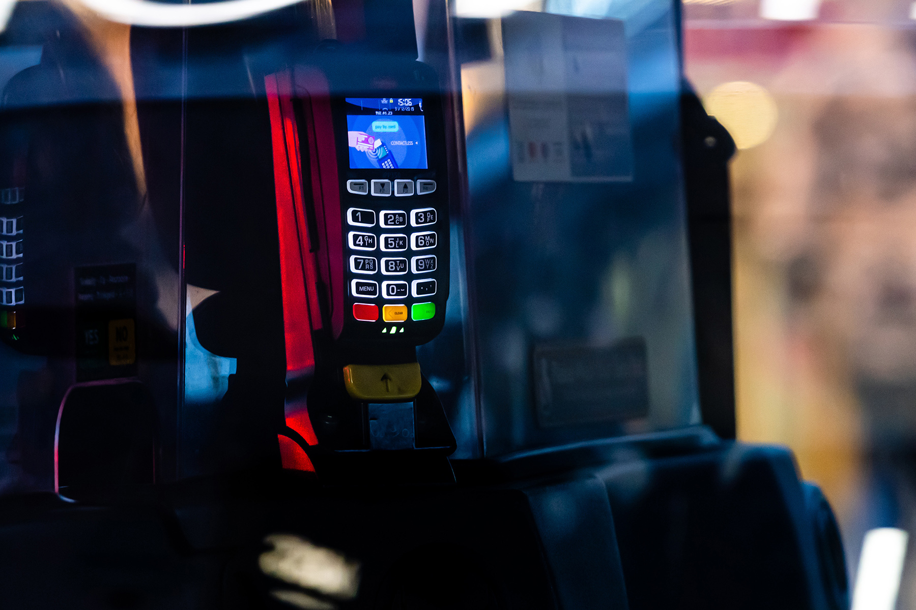 Contactless payment terminal inside of a London taxi