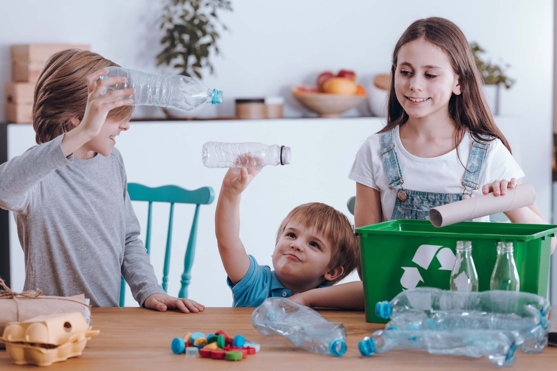 family sorting recycling in UK