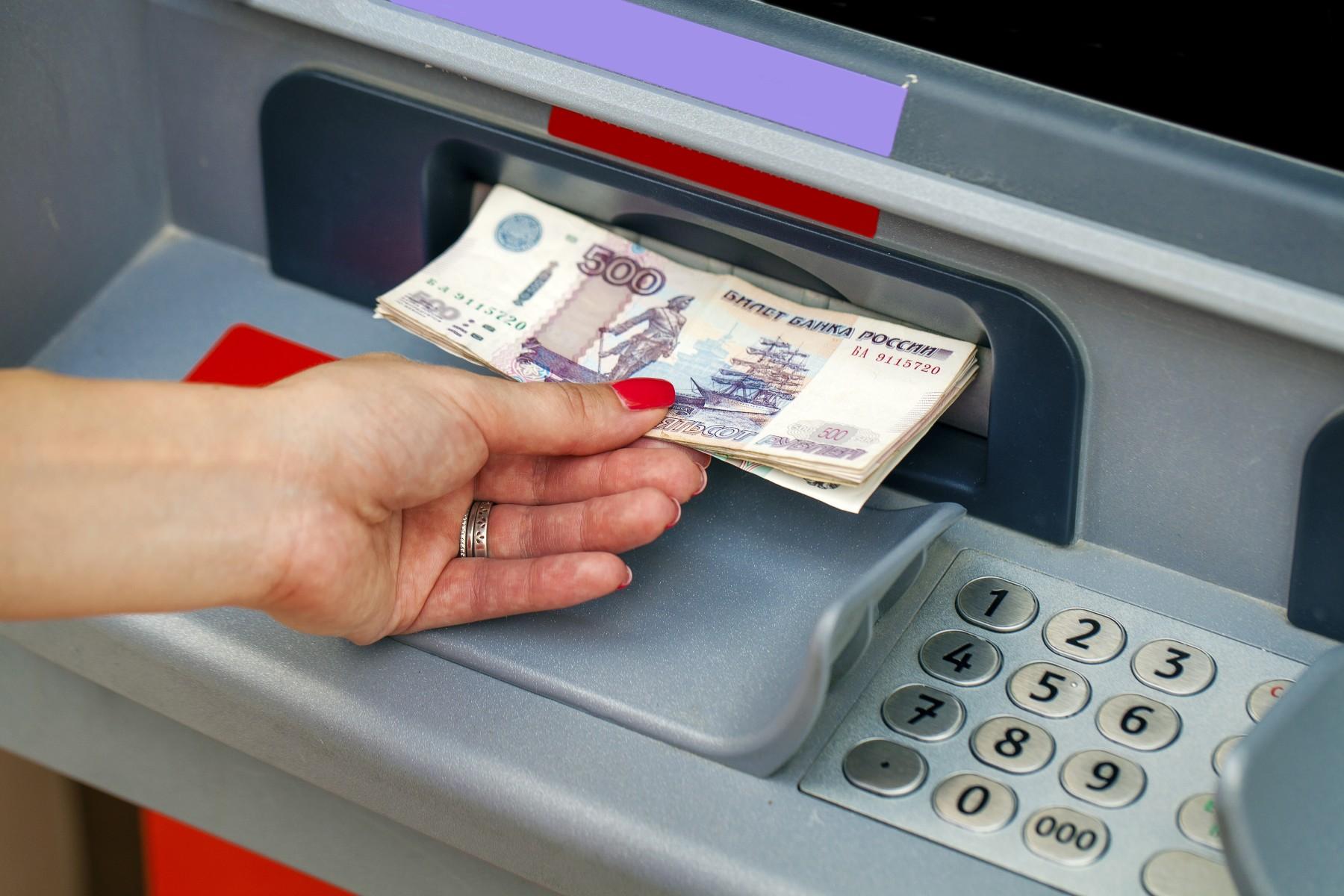 Russian bank account, woman using cash machine in Russia