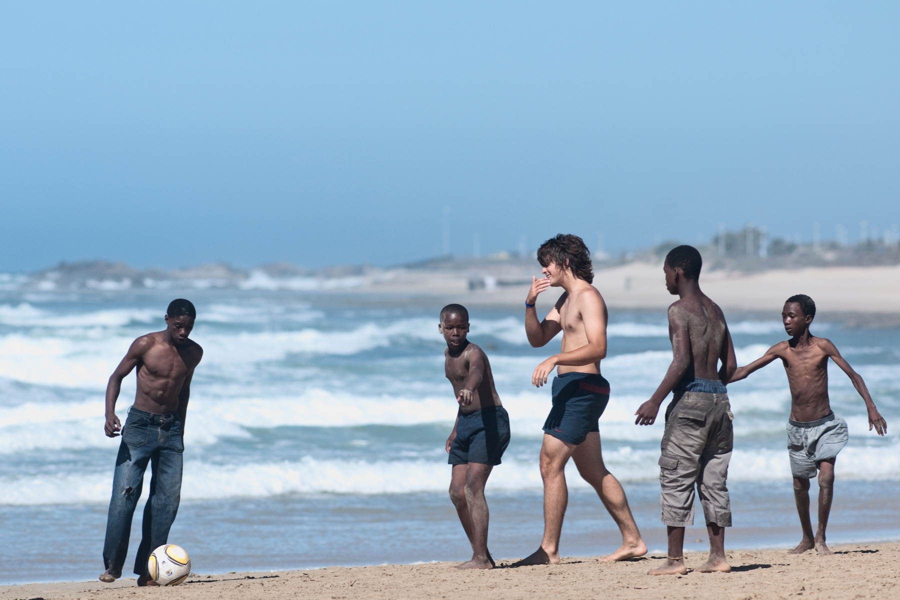Playing football on the beach in South Africa