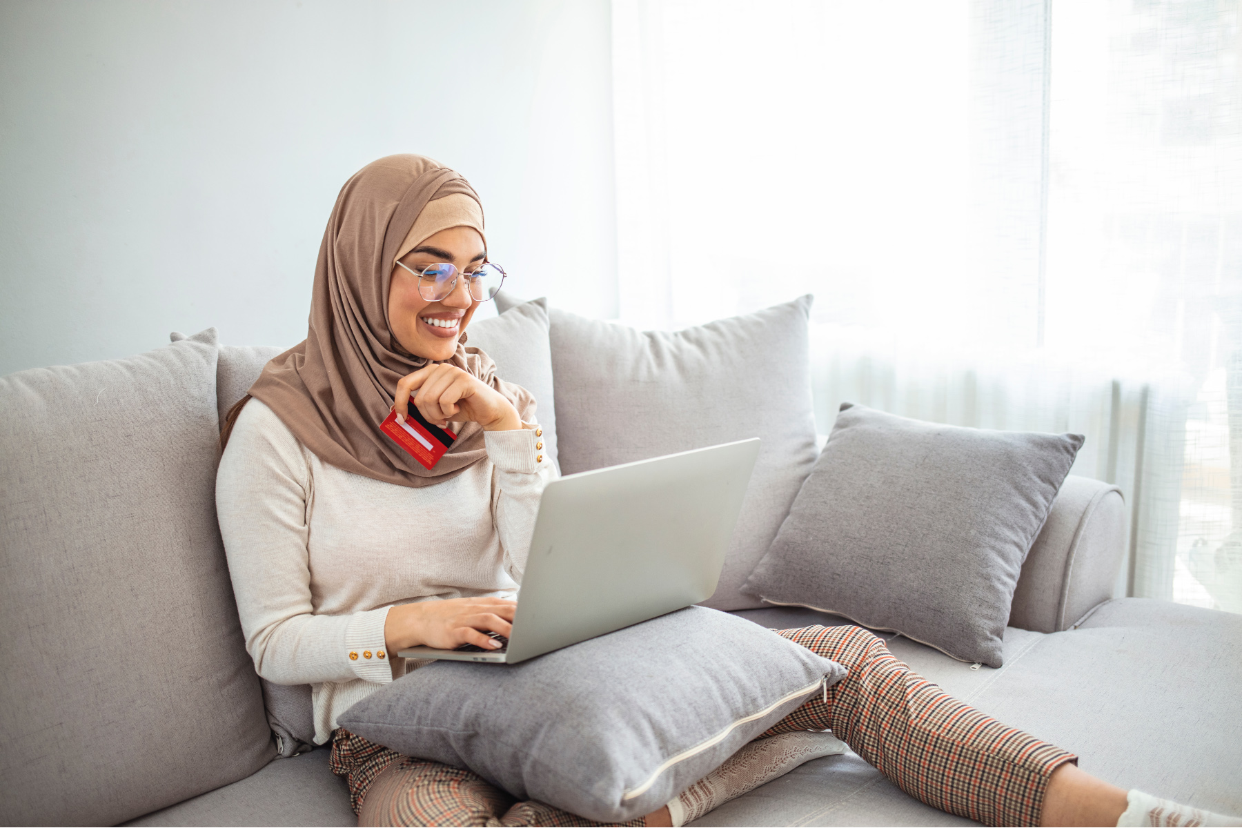 Woman banking online on her laptop