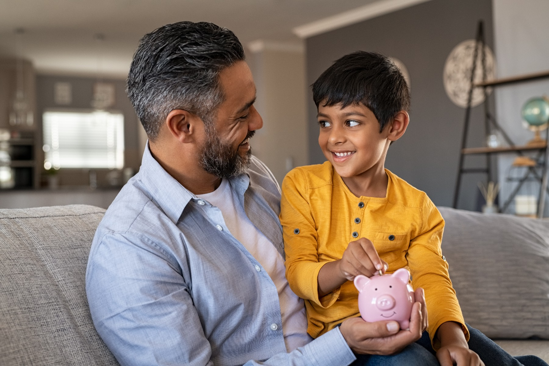 father and son with a piggy bank, South African bank account