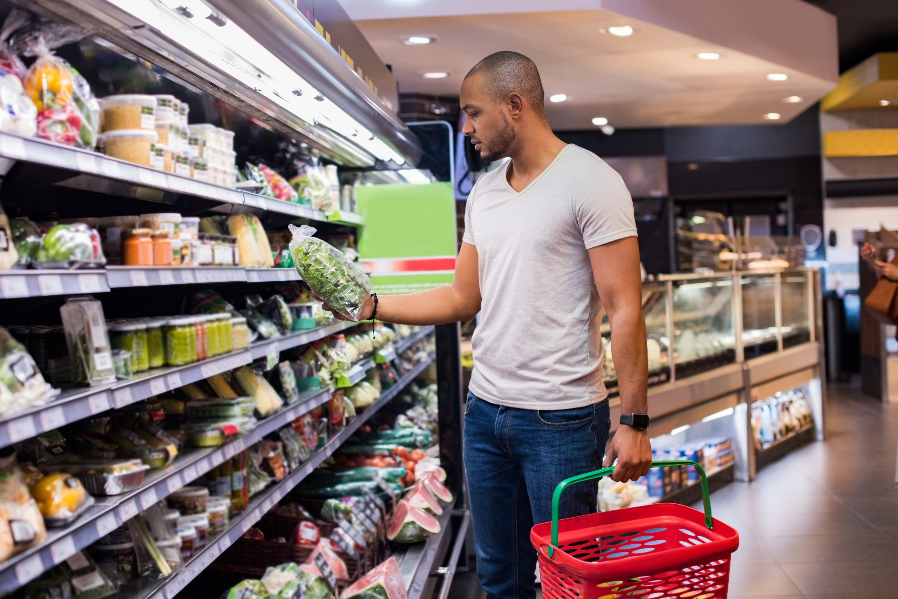 young man shops for groceries in south african supermarket