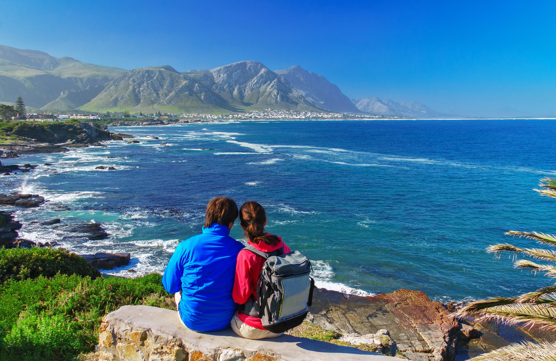 couple looking at the coastline in South Africa