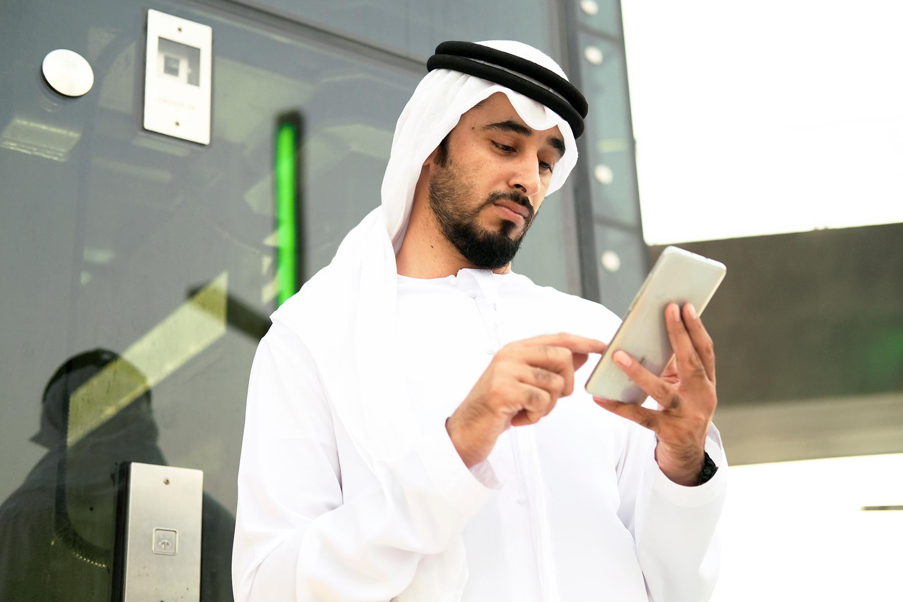 Qatari man using his mobile phone