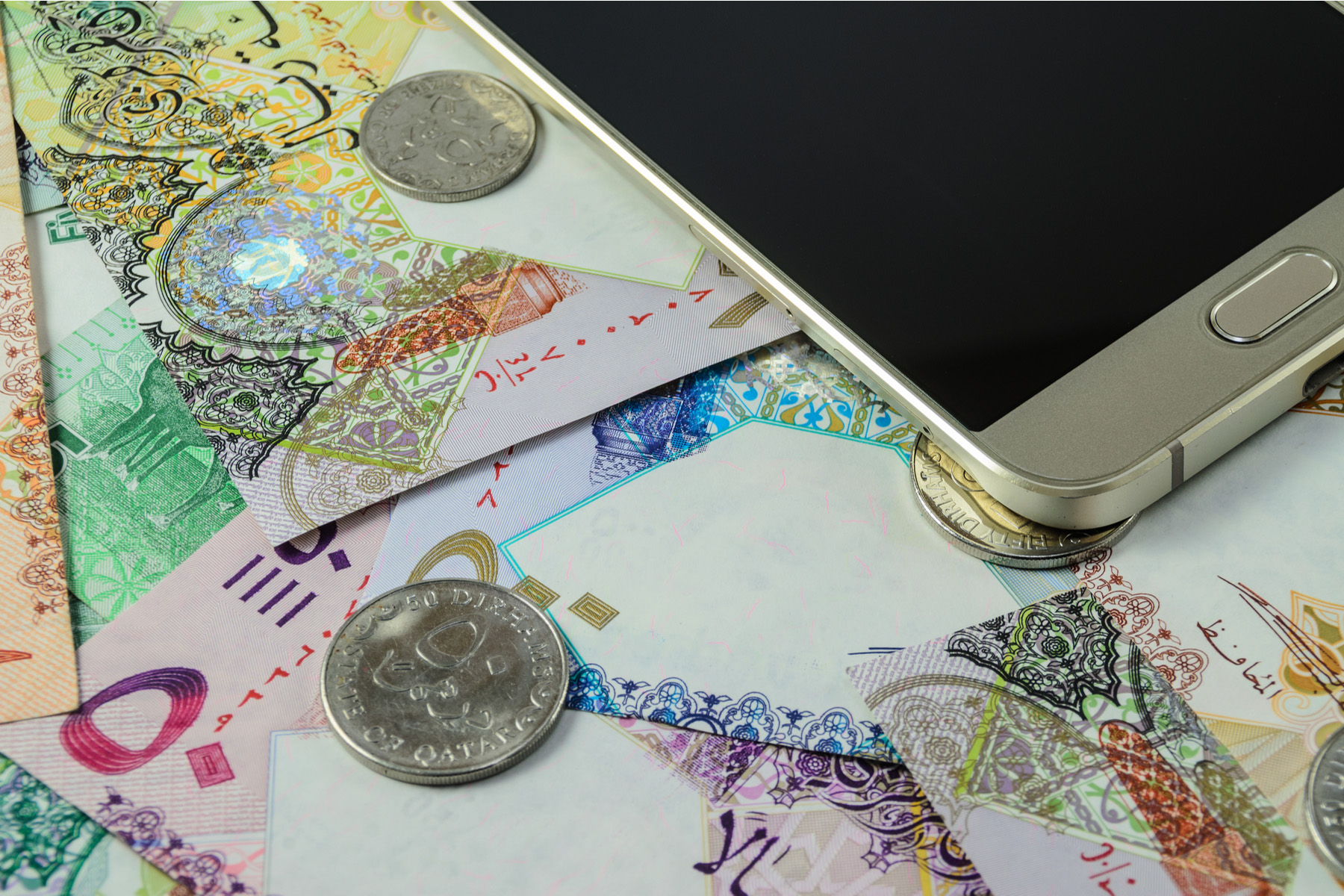 Qatari money and a mobile phone