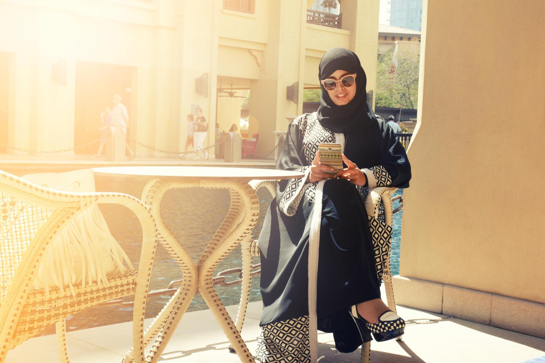 Qatari woman using her mobile phone