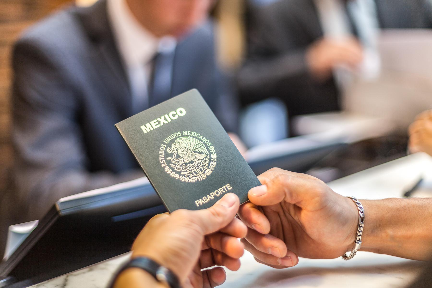 Traveler holding a Mexican passport