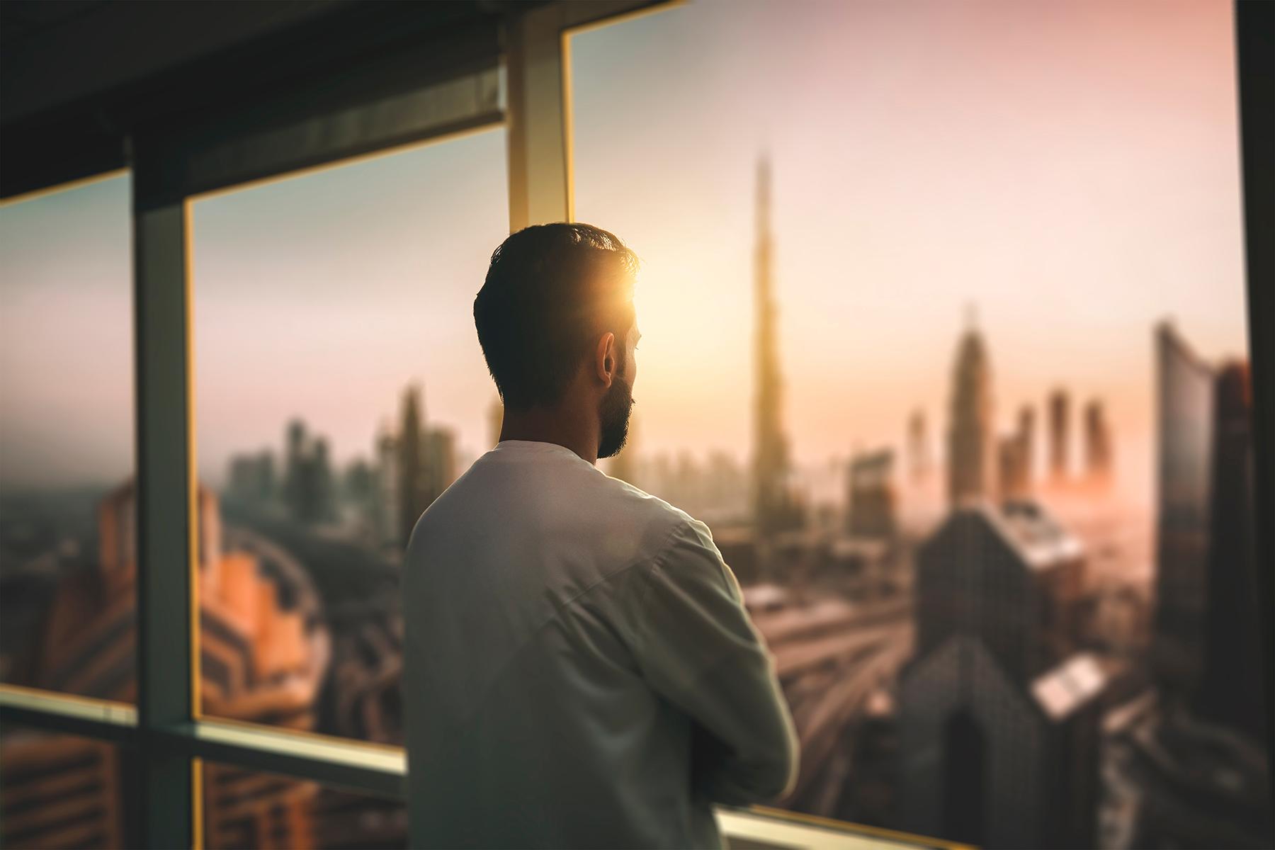 Businessman looking at the Dubai skyline