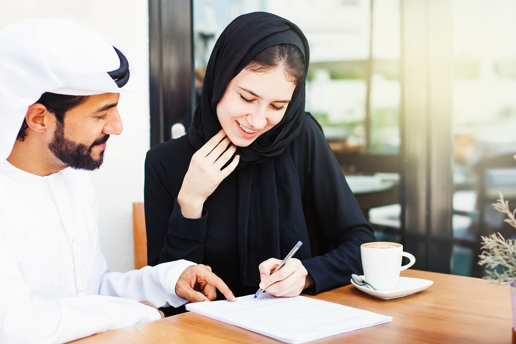 Emirati woman signing contract