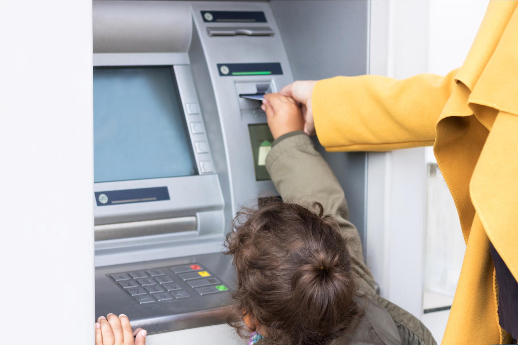 Kid using ATM