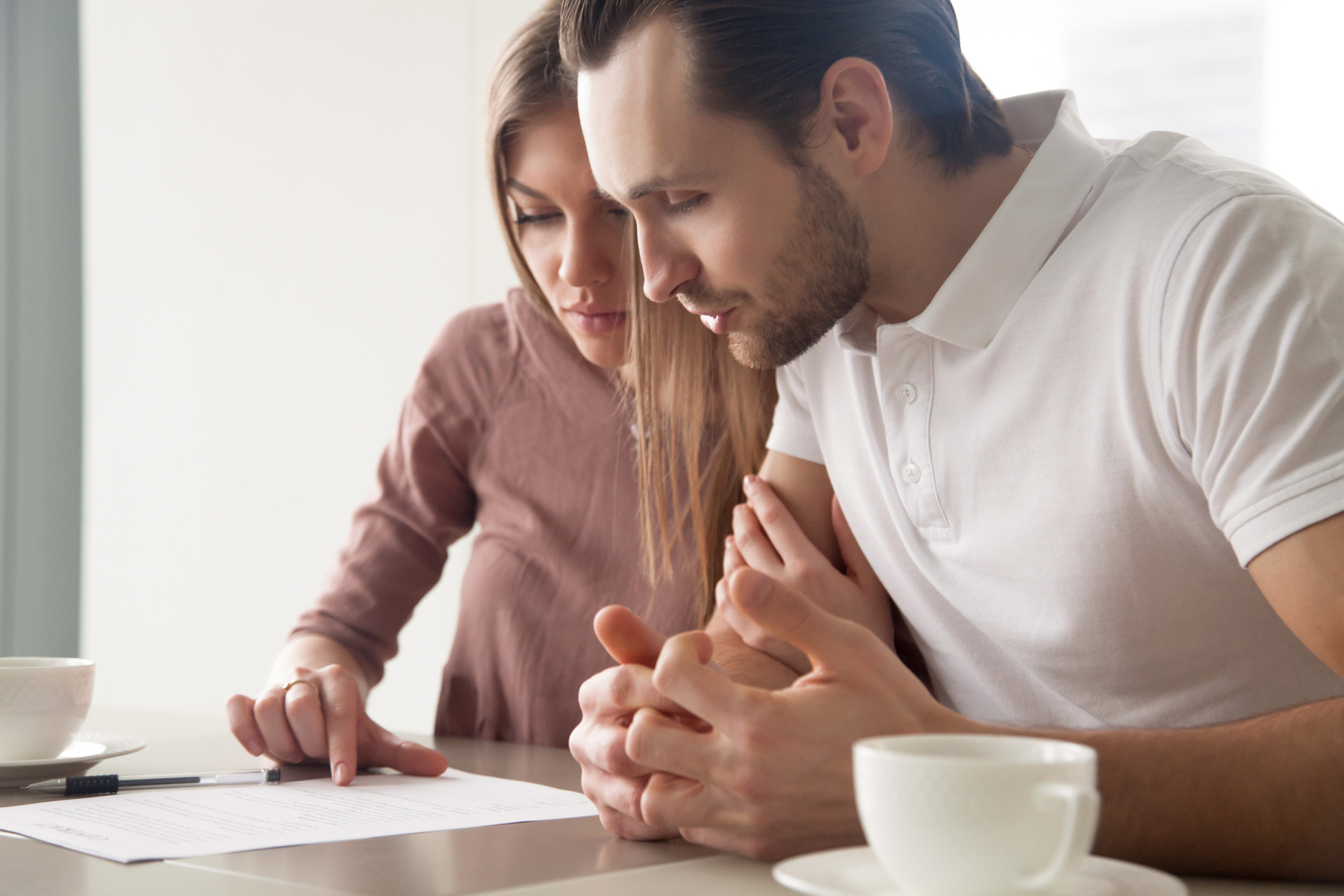 Couple reading mortgage contract
