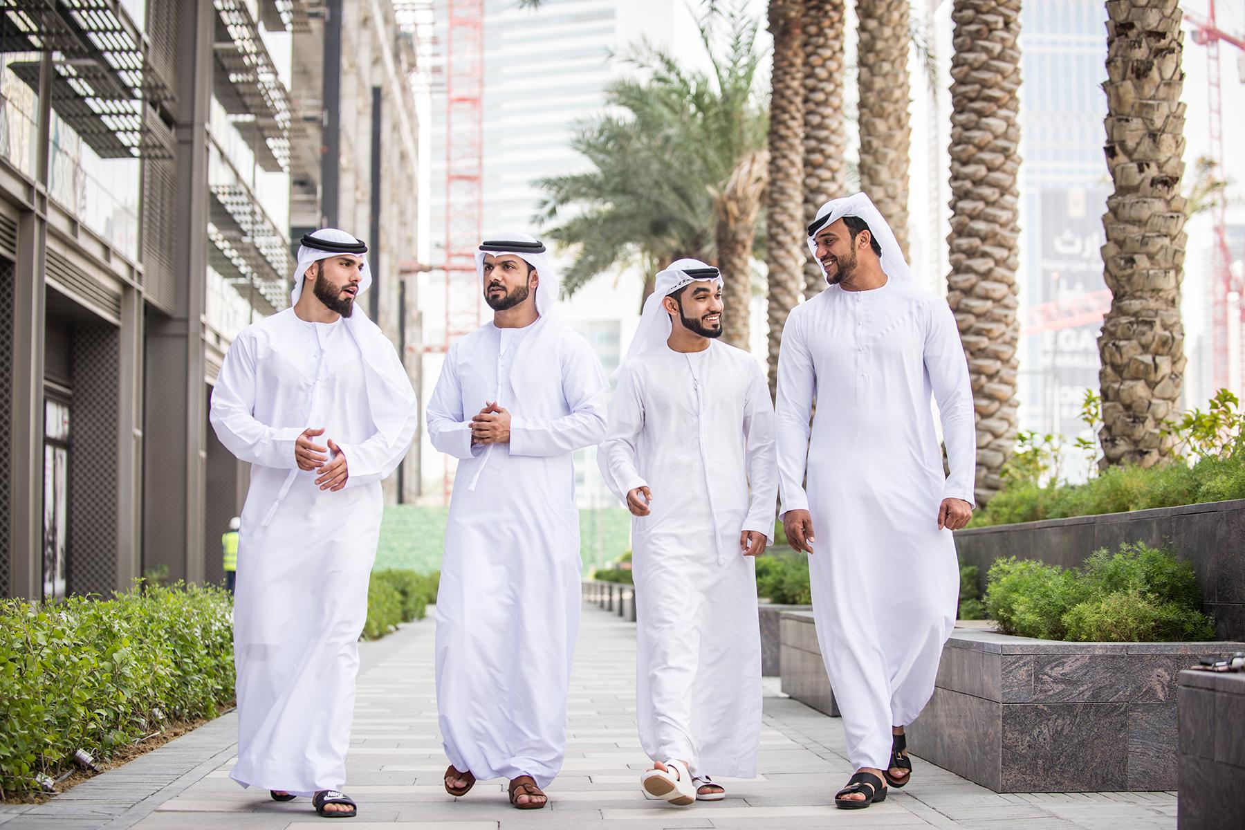 Emirati businessmen walking
