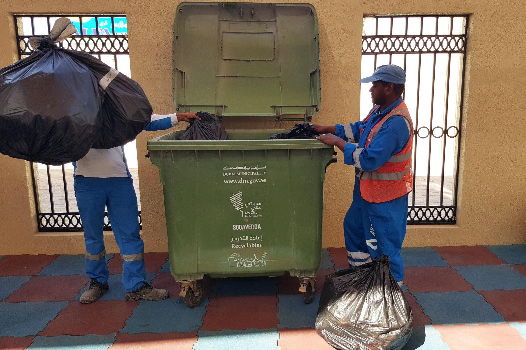 Trash collectors in Dubai