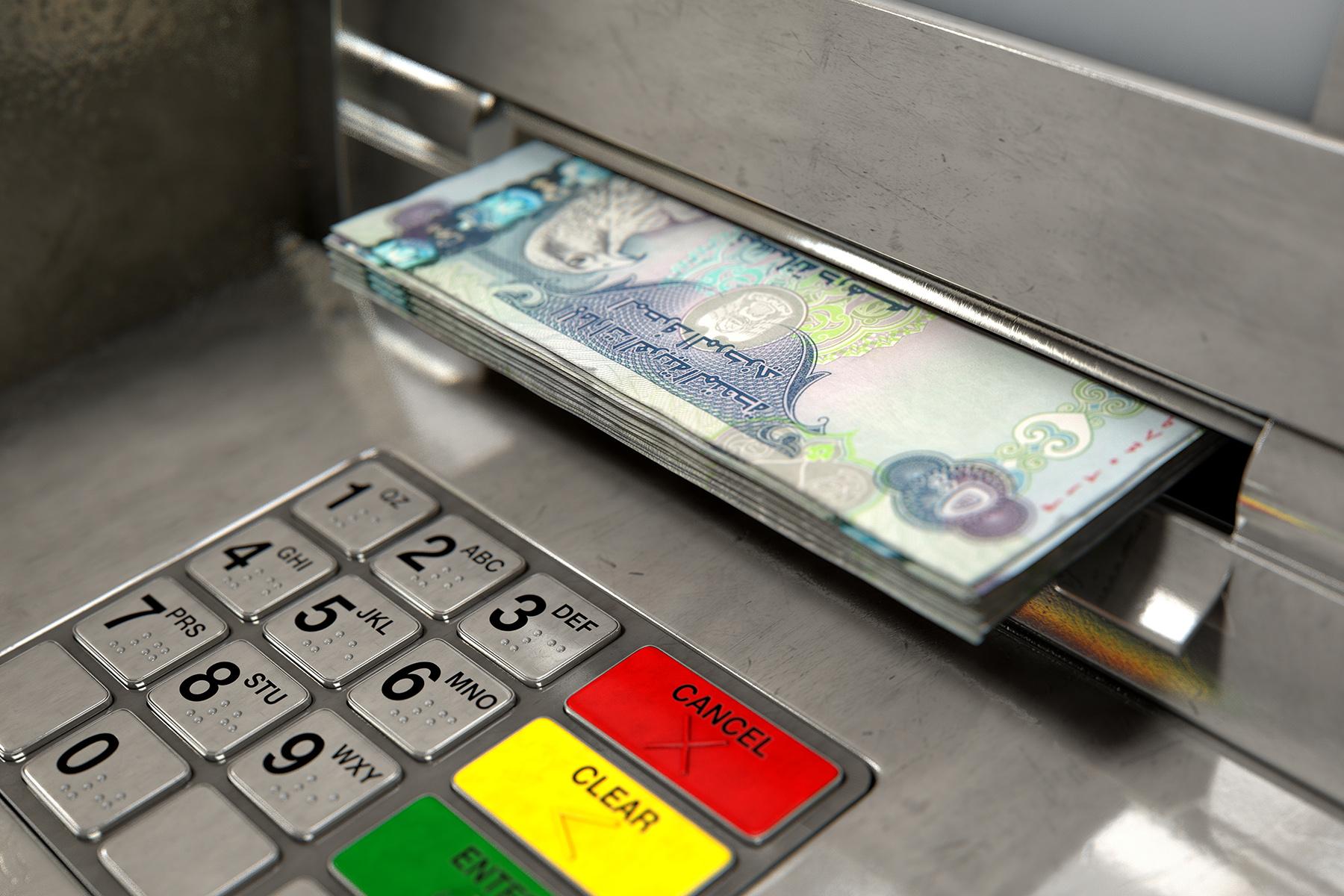 ATM dispensing Emirati dirham notes