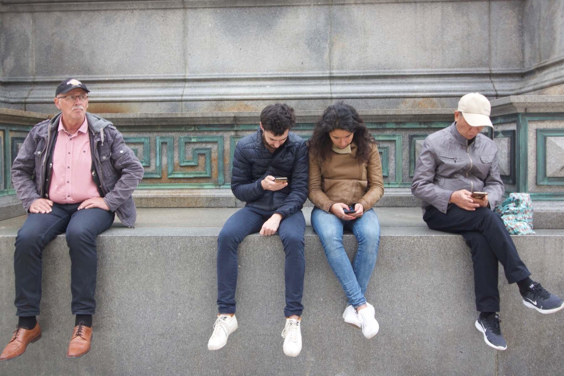 people on mobile phone austria