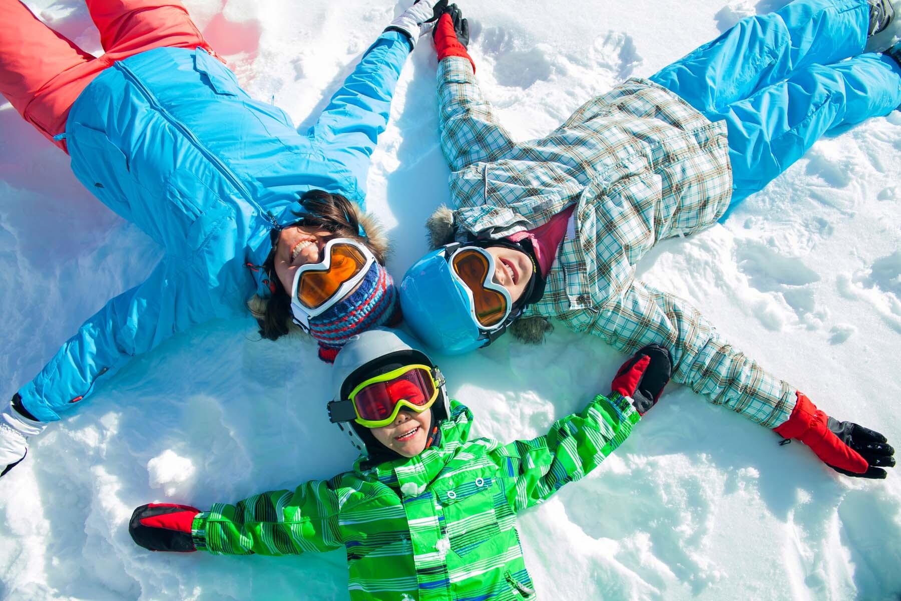 family skiing in austria