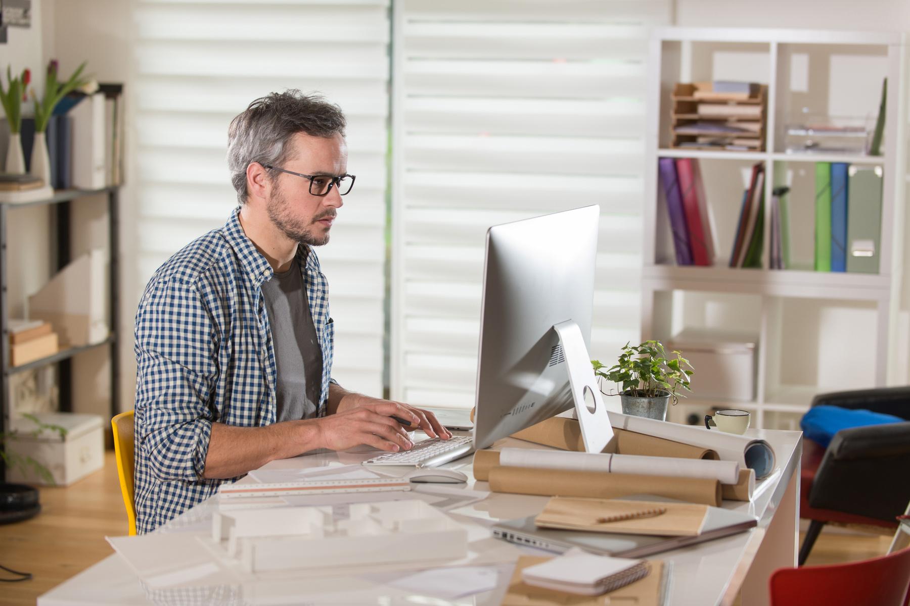 Entrepreneur working at his computer
