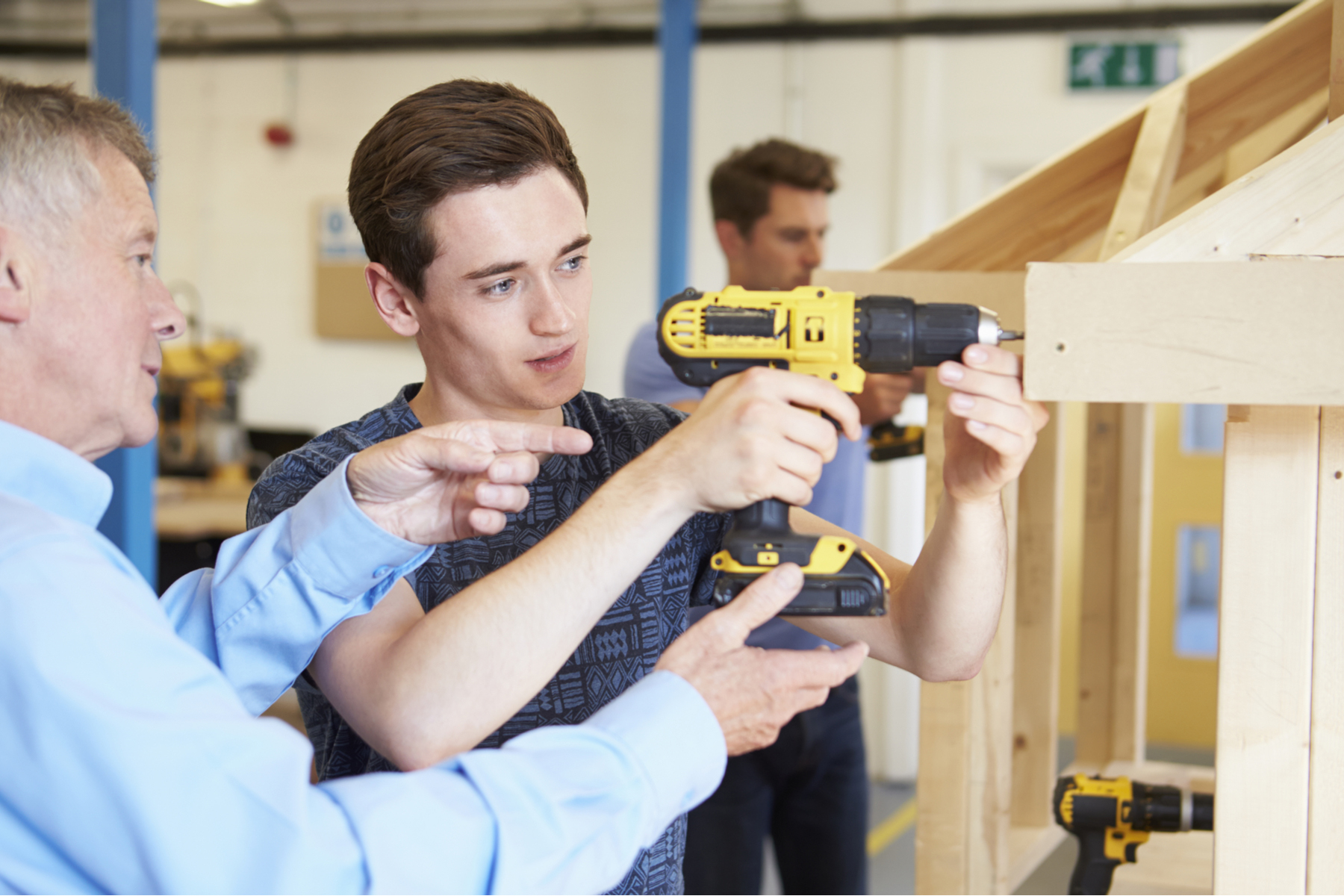 Teenager learning woodwork
