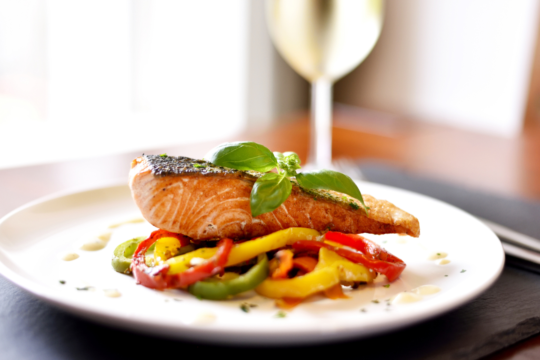 Salmon dinner with a glass of white wine