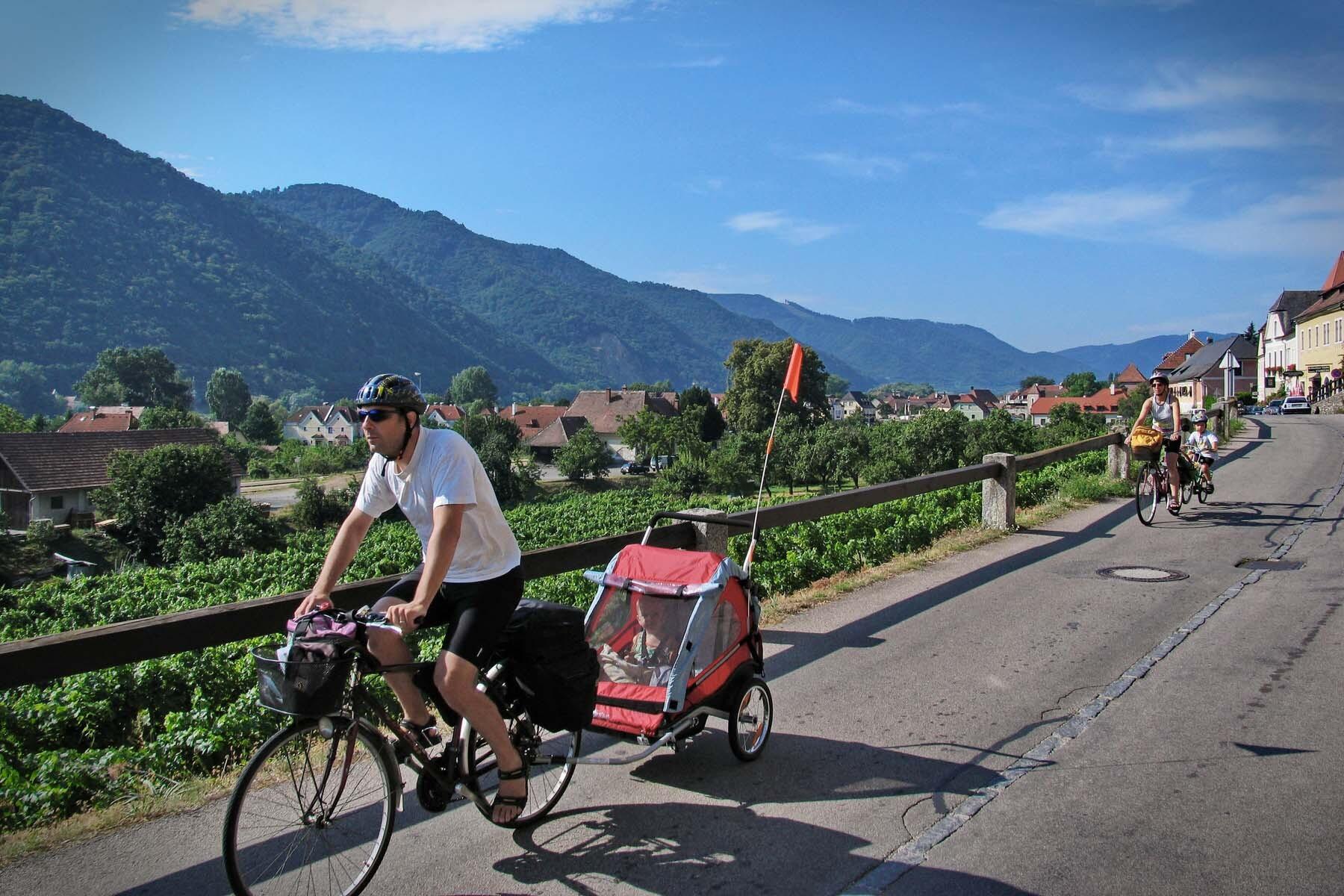 Family cycling through Austria