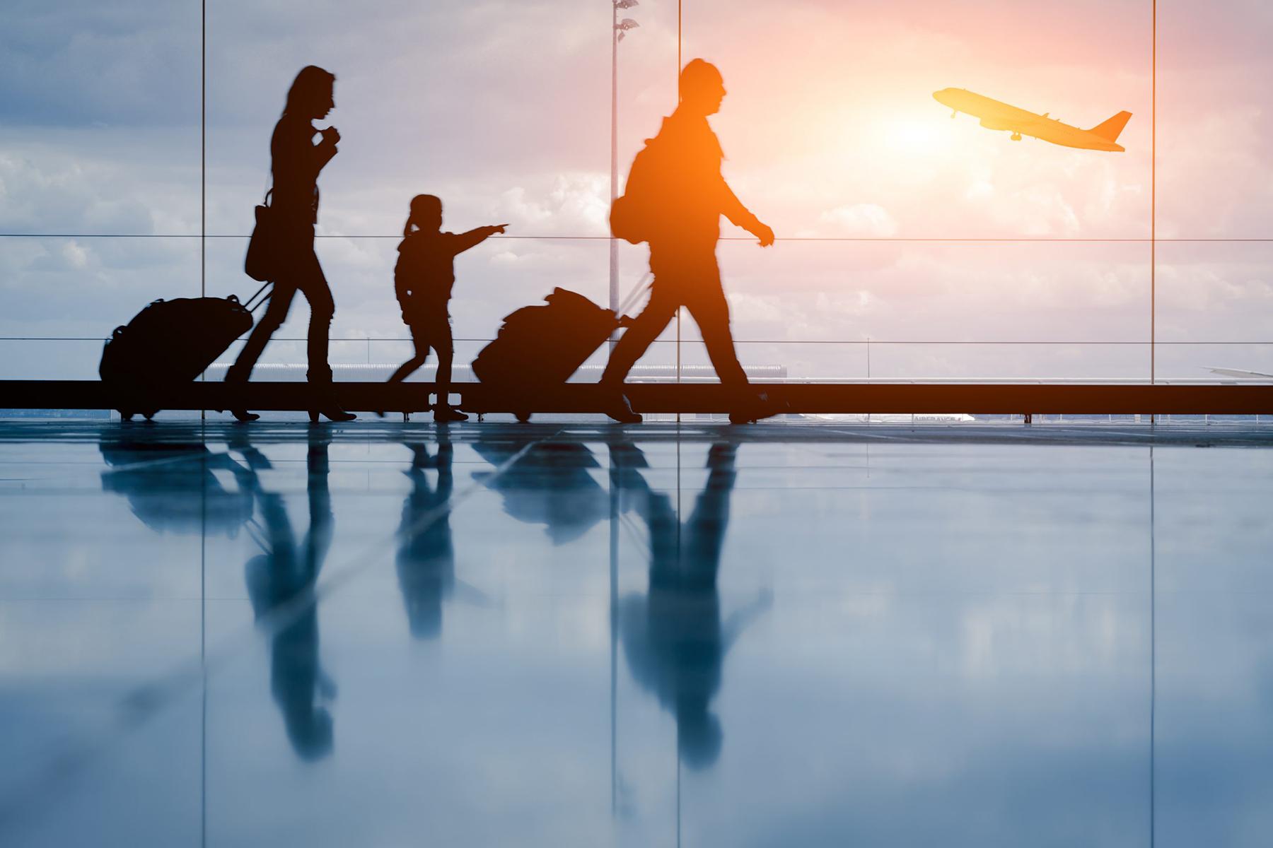 Family walking through an airport