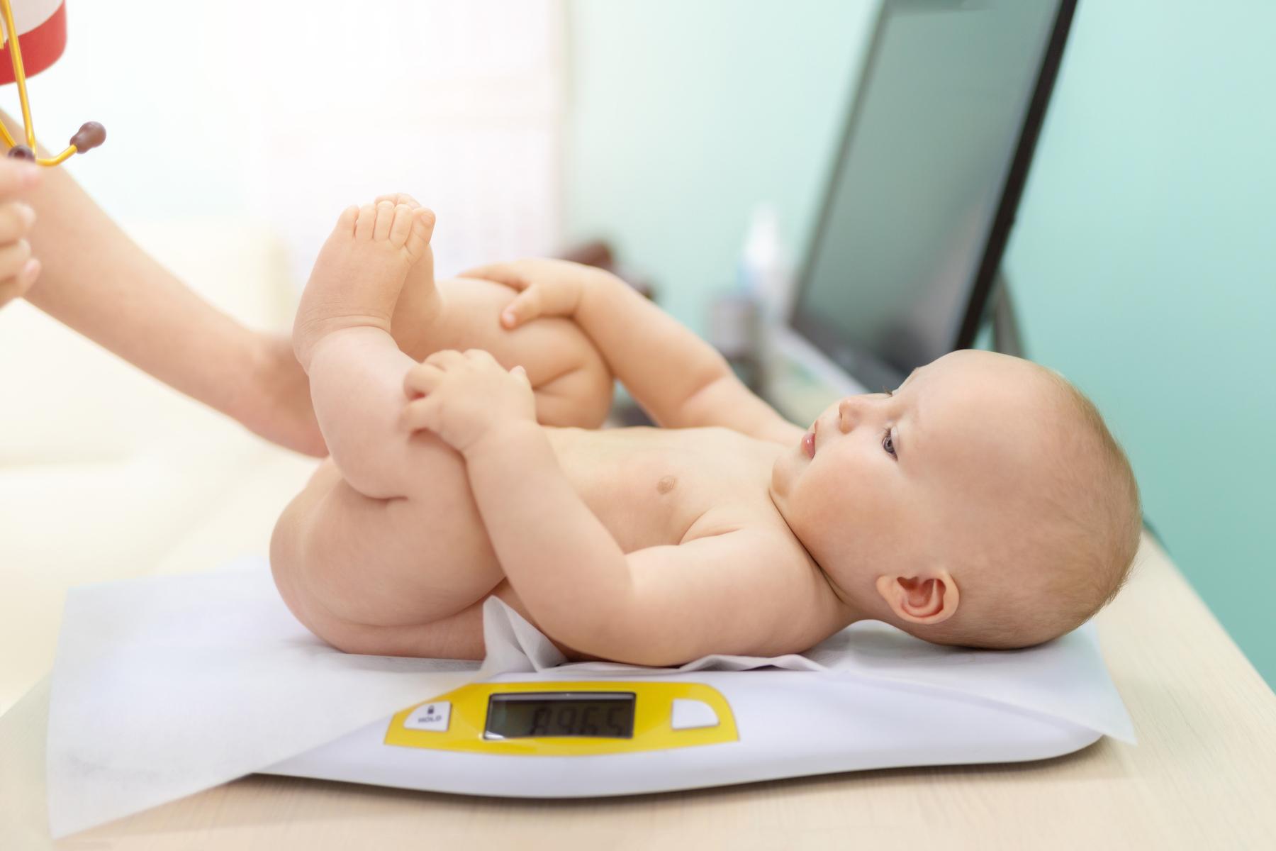 Weighing newborn baby