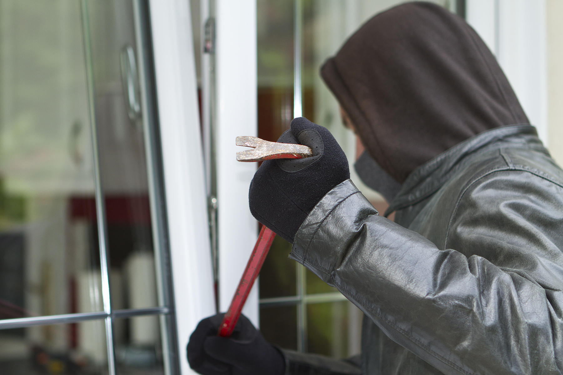 Burglar breaking into Austrian home