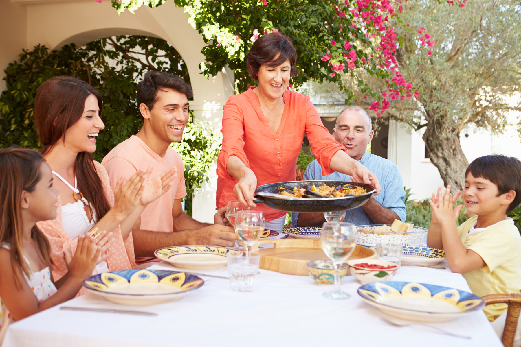 Spanish family eating paella together