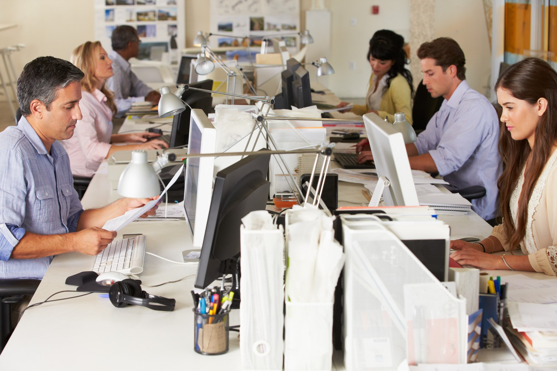 Team of workers in busy Spain office