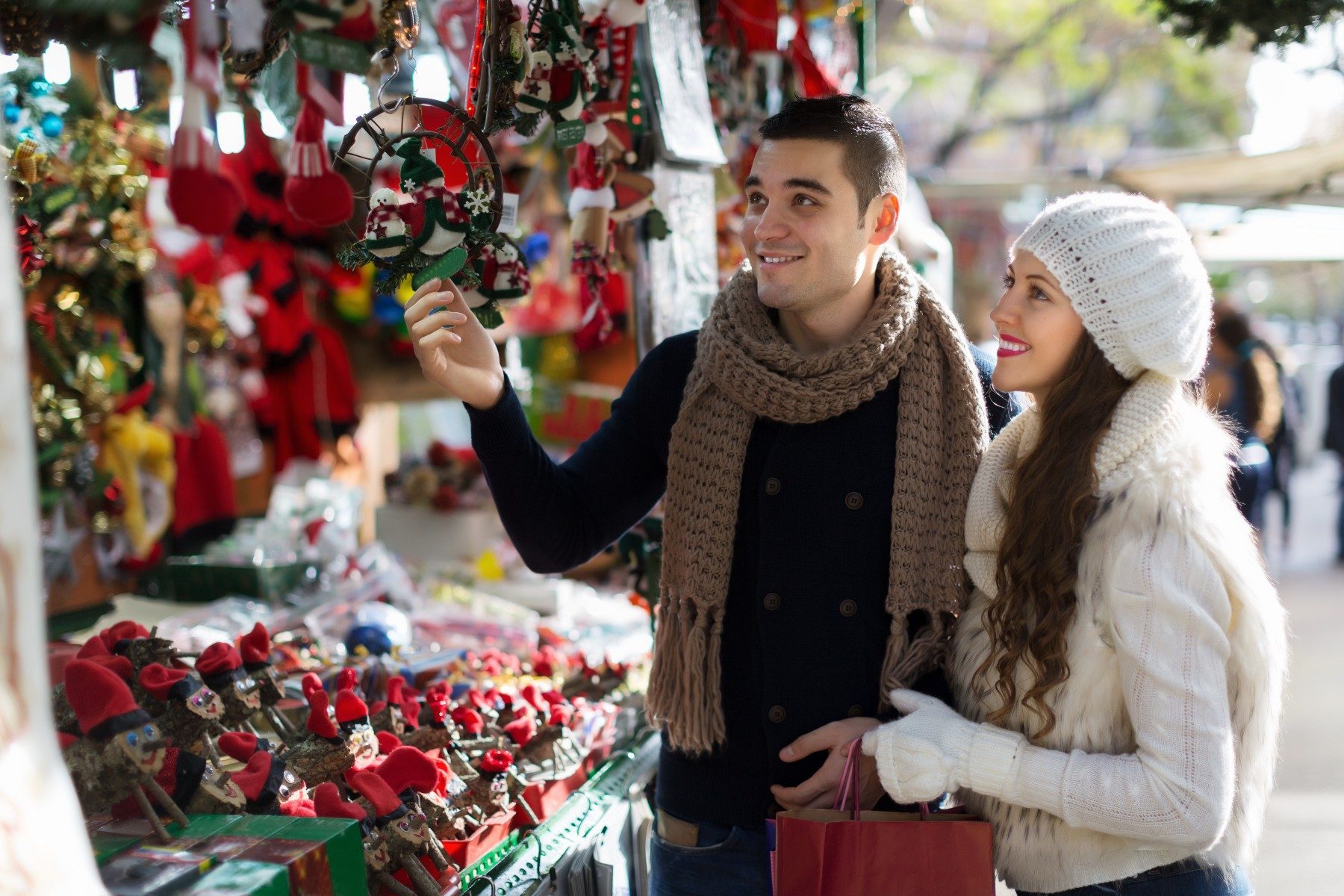couple buying souvenirs at Spain Christmas market