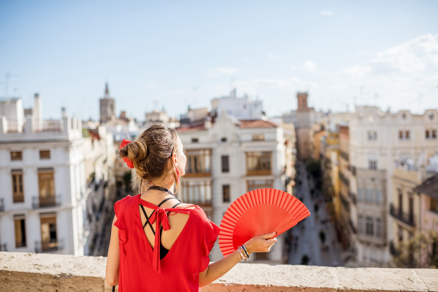 Woman on balcony in Valencia, warm weather in Spain